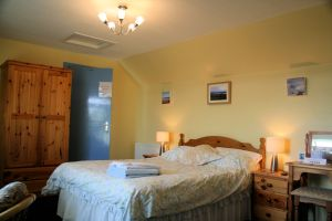 The double/family bedroom at Tranquility Bed and Breakfast is available with various combinations of sleeping accommodation.