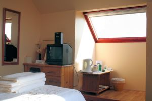 The double bedroom at Tranquility has superb views looking out across The Minch towards the Isle of Lewis.