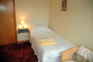 The single bedroom at Tranquility B & B has private bathroom facilities with both bath and shower.